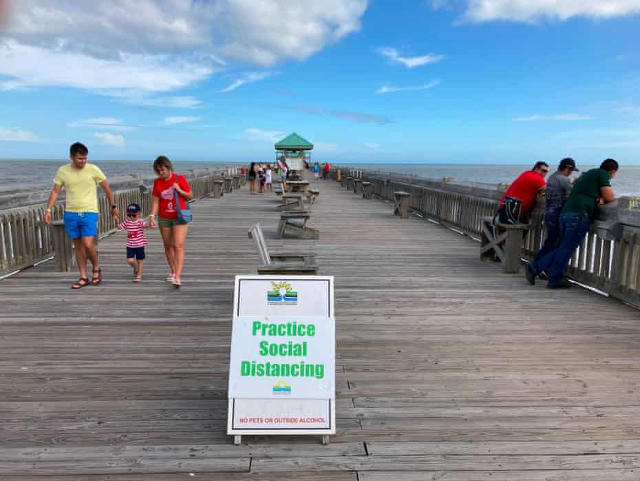 Folly Beach in South Carolina last weekend. Dr Fauci this week said that new localized outbreaks were 'inevitable' as mitigation measures are relaxed.