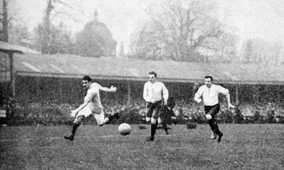 Manchester City's Billy Meredith (left) charges down the wing during the 1904 FA Cup final against Bolton Wanderers.