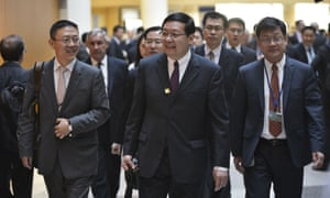 Lou Jiwei, centre, arrives for a G20 finance ministers' and central bank governors' meeting at the IMF on 15 April.