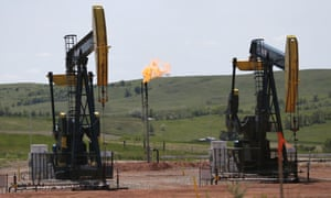 Natural gas (methane) is burned off near pumps in Watford City, North Dakota. The Trump administration is seeking to roll back regulations on methane leaks from oil and gas facilities.