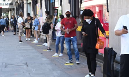 Keep your distance: shoppers on Oxford Street as Primark and Selfridges re-open after lockdown.