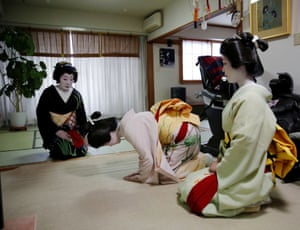 Mayu and Maki bow to Ikuko, who are all geisha, before making their way to work at a party being hosted by customers at a luxury restaurant, where they will be entertaining with other geisha, at Ikuko's home in Tokyo