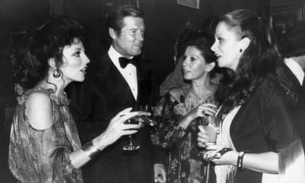 Stud Party 27th September 1977: British actress Joan Collins, writer Jackie Collins, actor Roger Moore and his wife Luisa Mattioli at a party celebrating the release of 'The Stud', a film based on a novel by her sister.