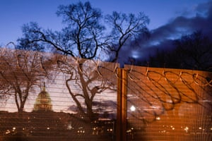 Razor wire and fences still surround the Capitol building at sunrise a few days after the inauguration of President Joe Biden and Vice President Kamala Harris.