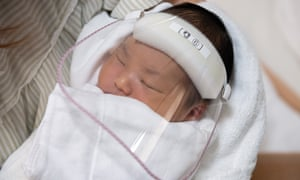 Three-day-old Kengo Saito wears a face visor to protect against Covid-19 on May 15, 2020 in Satte, Japan.