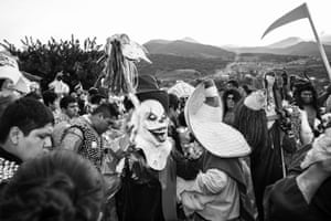 Revellers dance in the dawn light. The valleys echo to the sound of competing bands and processions. They will eventually meet up in San José, a town outside Oaxaca, to create one large and noisy parade.