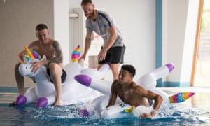 Jesse Lingard is pushed into a swimming pool by a member of the coaching staff at England's World Cup base in Repino.