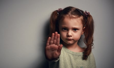 Little girl with her hand up in front of her