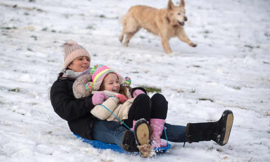 A mother and daughter sledging in Newcastle-under-Lyme in Staffordshire. More cold weather is on the way.