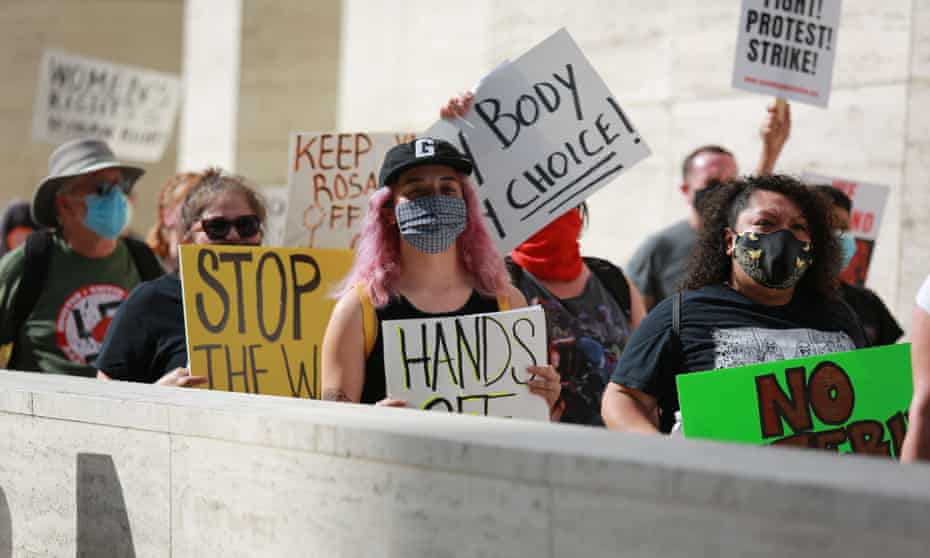 Protesters march from city hall to the federal court house in protest against the new state abortion law, in Houston.