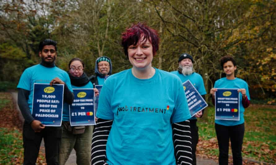 Emma Robertson and other members of the Just Treatment activist group outside the headquarters of Pfizer UK.