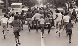 Children run after an open-top convertible carrying Kennedy in Crawfordsville, Indiana, in May 1968.