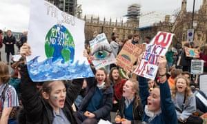 Schoolchildren take part in a climate strike in London, March 2019