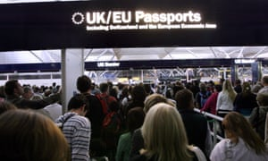 Passengers queue for  passport control at Stansted airport.