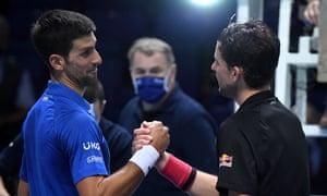 Novak Djokovic congratulates Dominic Thiem at the end of their three-hour fight