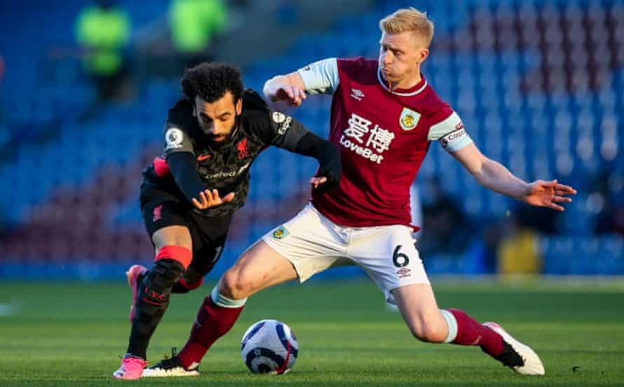 Ben Mee halts Liverpool's Mohamed Salah in May.