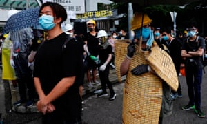 Anti-extradition bill protesters wear protective equipment during a demonstration.