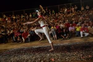 A woman walks on burning embers during the night of San Juan