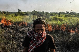 Pekanbaru, IndonesiaVillagers of Palas watch the fire burning forests and peatlands
