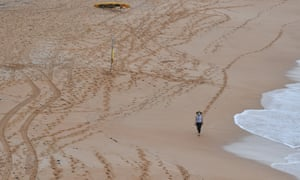 A lonely walk on a lonely Avalon beach during the northern beaches lockdown.