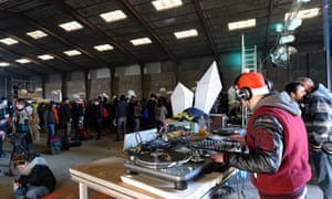 A DJ plays music during a party in a disused hangar in Lieuron about 40km south of Rennes, on January 1, 2021.