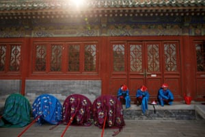 Performers rest after a rehearsal of a re-enactment of a Chinese New Year Qing Dynasty ceremony