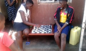 Joan Nakimuli (left) and Stellah Babirye at the Katwe chess academy in Kampala, where they also sleep.