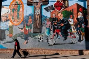 A pedestrian passes Sagrado Corazon