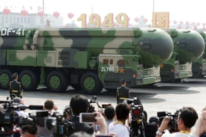Military vehicles carrying DF-41 intercontinental ballistic missiles travel past Tiananmen Square during the military parade.