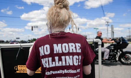 People gather to protest against the resumption of federal executions