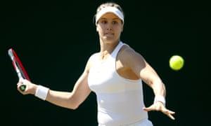 Eugenie Bouchard of Canada returns a shot during a Wimbledon qualifying match