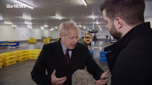 Boris Johnson being questioned over the picture of the ill child sleeping on the floor of Leeds hospital by an ITV journalist.