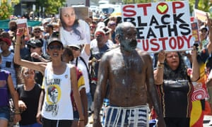 Aboriginal and Indigenous rights campaigners protest Aboriginal deaths in custody on the streets of Brisbane in November 2014.