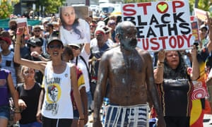 Indigenous rights campaigners the Brisbane Blacks, protest about Aboriginal deaths in custody during the G20 in Brisbane on 14 November 2014.