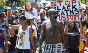 Indigenous rights campaigners protest about Aboriginal deaths in custody at the Brisbane G20 summit.