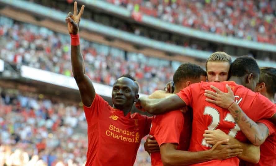 Sadio Mané celebrates with team-mates after Divock Origi Liverpool's third goal during the 4-0 win over Barcelona.