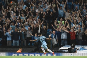 The Etihad erupts as Manchester City's Sergio Aguero wheels away in celebration after opening the scoring.