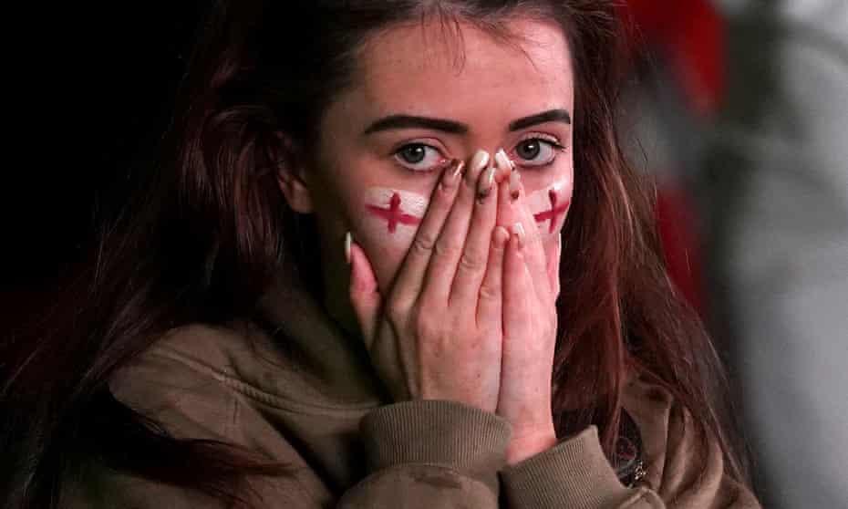 Dejected England fan in Trafford Park Manchester on 11 July
