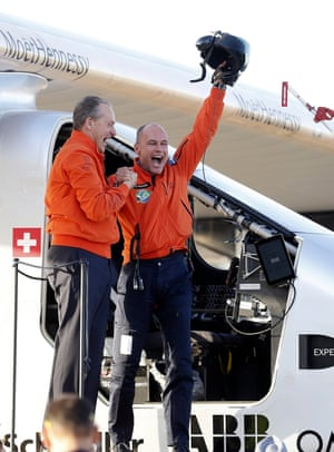 Piccard and Andre Bordchberg celebrate after landing at Seville's San Pablo airport in southern Spain on 23 June after a 70-hour flight over the Atlantic ocean from New York.