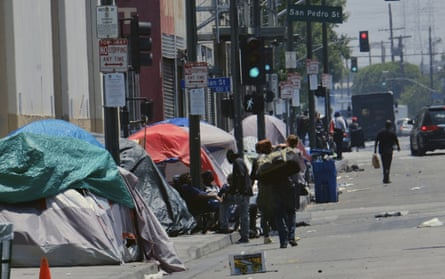 Homeless camps line a street in downtown Los Angeles.