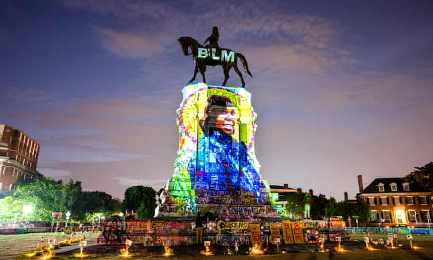 Black Lives Matter becomes global rallying cry for justice<br>epa08763974 YEARENDER 2020 BLACK LIVES MATTER A photograph of Breonna Taylor, who was killed in her own apartment by Louisville police officers, is projected onto a statue of Confederate General Robert E. Lee on Monument Avenue in Richmond, Virginia, USA, 06 July 2020. While other Confederate statues along Monument Avenue were coming down, a lawsuit was temporarily preventing the Lee statue from being removed. EPA/JIM LO SCALZO *** Local Caption *** 56199789