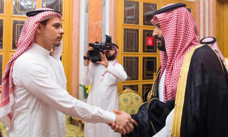 Salah bin Jamal Khashoggi shakes hands with Prince Mohammed on Tuesday.