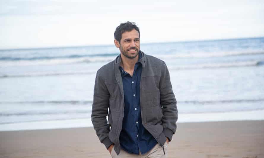 Michael Raymond on a beach
