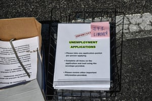 Unemployment forms at a drive-thru collection point outside John F Kennedy Library in Hialeah, Florida, on 8 April.