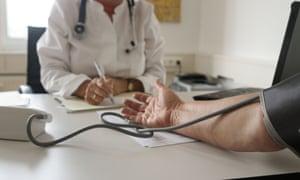 A GP takes a patient's blood pressure