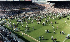 Thousands of fans on the pitch during the FA Cup semi-final at Hillsborough in April 1989