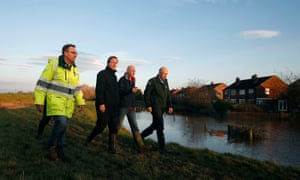 David Cameron looks at the flood defence system on Warwick Road in Carlisle