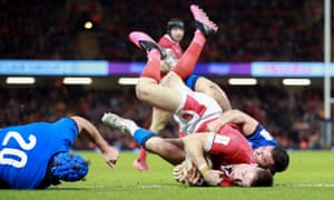 Josh Adams scores the final try for Wales against Italy, his third of the game.