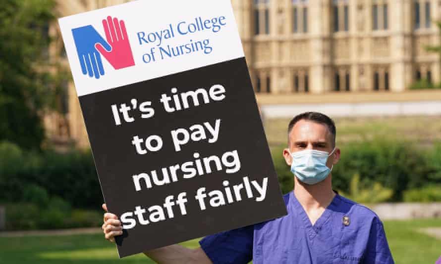 A nurse holding a placard