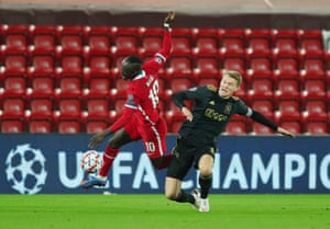 Liverpool's Sadio Mane is fouled by Ajax's Perr Schuurs .